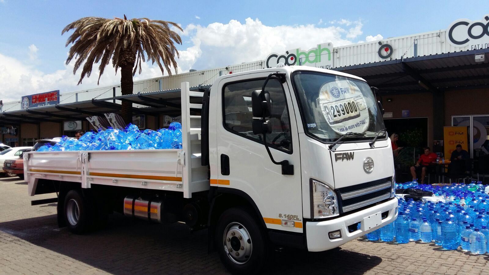 FAW trucks carrying water
